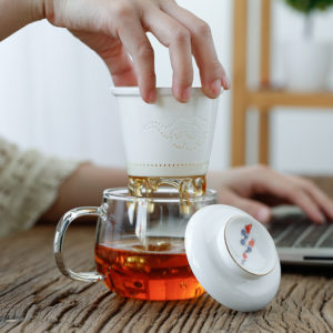 tea cup with infuser clouds